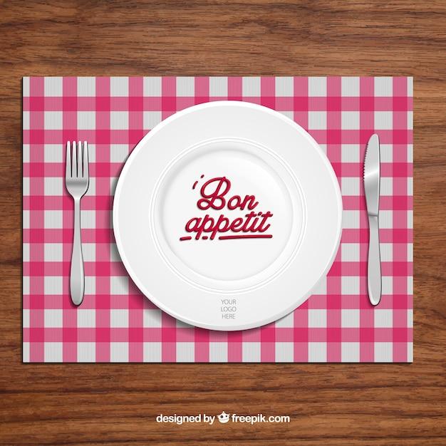 Restauranthintergrund mit teller und tischbesteck Kostenlosen Vektoren