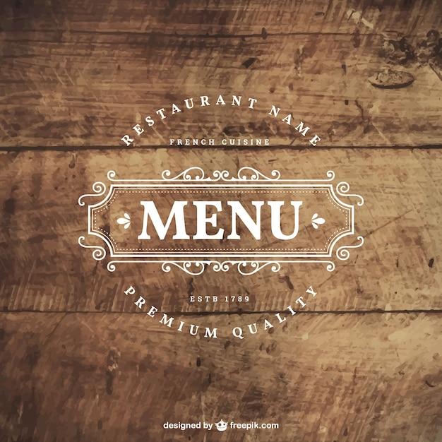 Retro restaurant-abzeichen auf holz Kostenlosen Vektoren