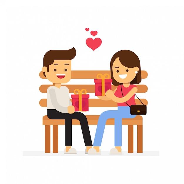 Romantisches paar, das auf einer bank sitzt und sich geschenke zum valentinstag schenkt Premium Vektoren