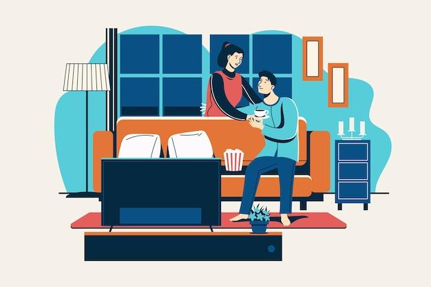 Romantisches paar, das heißes getränk im wohnzimmer trinkt Premium Vektoren