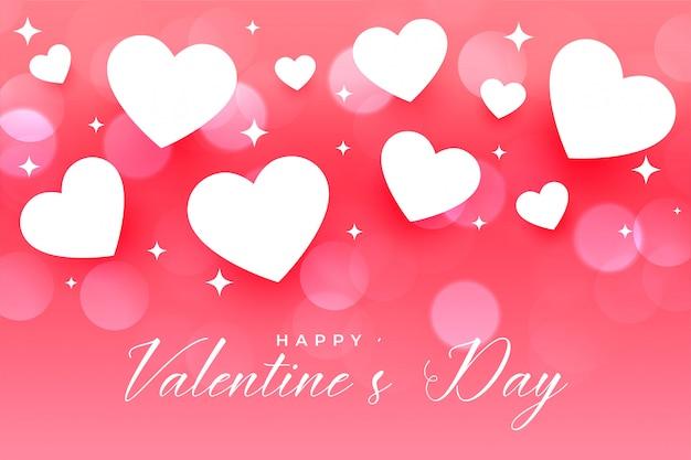 Rosa grußkarte der schönen herzen des glücklichen valentinstags Kostenlosen Vektoren