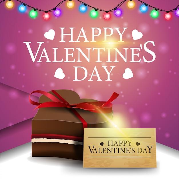 Rosa grußkarte zum valentinstag mit praline Premium Vektoren