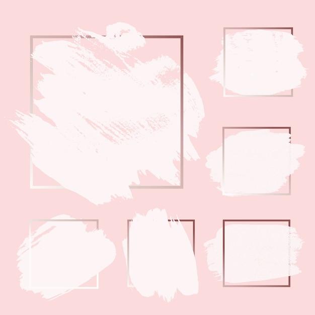 Rosa rose gold grunge brush-farben-tintenanschlag mit den quadratischen rahmenhintergründen eingestellt. Premium Vektoren