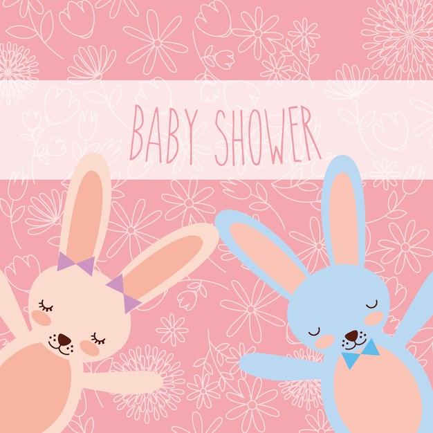 Rosa und blaue häschengrußkarte der babyparty Premium Vektoren