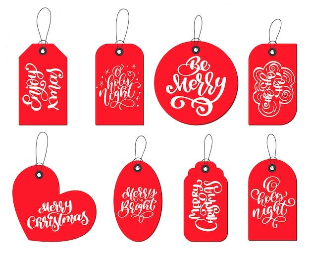 Rot beschriftet tagsammlung mit der kalligraphie, die weihnachtszitate beschriftet Premium Vektoren