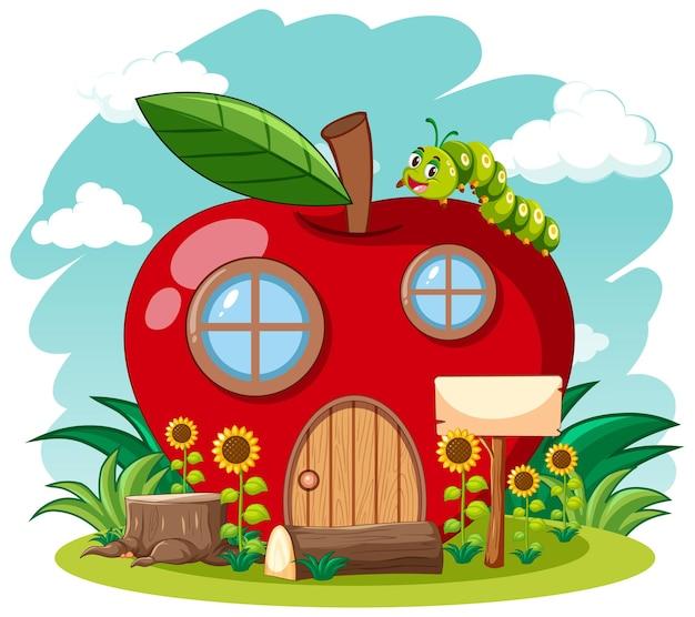Rotes apfelhaus und niedlicher wurm im gartenkarikaturstil auf himmelhintergrund Kostenlosen Vektoren