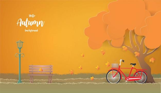 Rotes fahrrad unter dem baum in der herbstillustration. Premium Vektoren