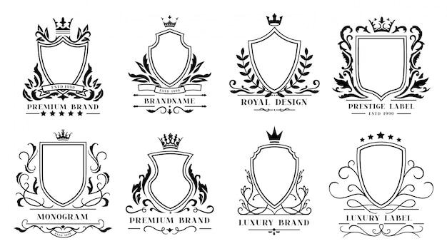 Royal shields abzeichen. vintage zierrahmen, dekorative königliche wirbel heraldische grenzen und luxus filigrane hochzeit embleme ikonen gesetzt Premium Vektoren