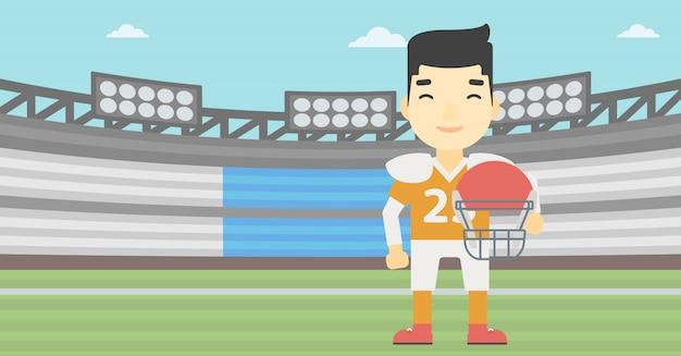 Rugbyspieler mit ball und sturzhelm in den händen. Premium Vektoren