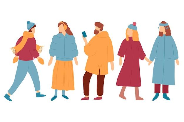 Sammlung junge leute, die winterkleidung tragen Kostenlosen Vektoren