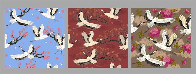 Sammlung nahtloser muster mit kranichvögeln. Premium Vektoren