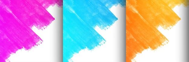 Sammlung von drei bunten pinselstrichdesign-hintergrundvektor Kostenlosen Vektoren