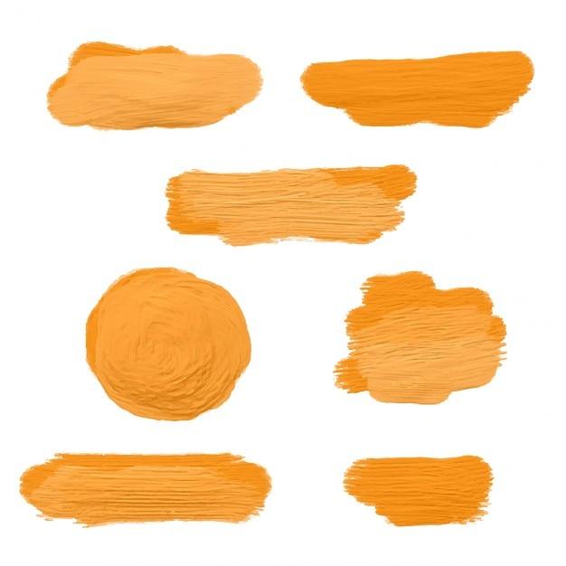 Sammlung von gold-acrylfarbe abstrichen Kostenlosen Vektoren