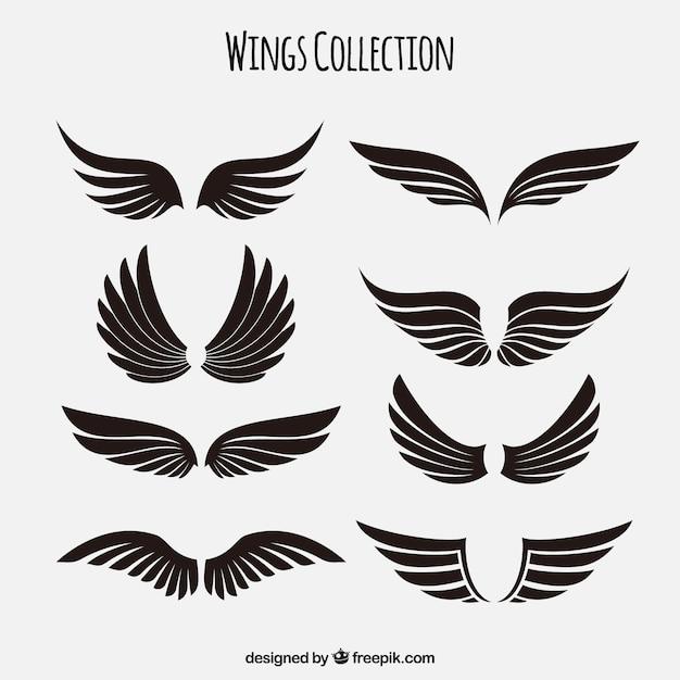 Sammlung von schwarzen flügeln Kostenlosen Vektoren