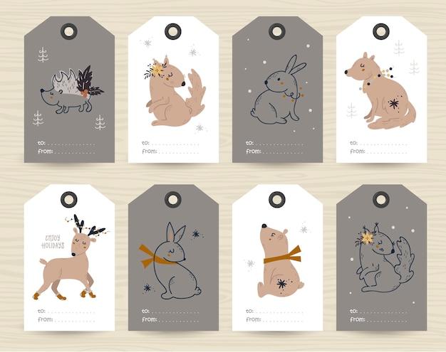 Sammlung von tags mit weihnachtsartikeln und tieren. Premium Vektoren
