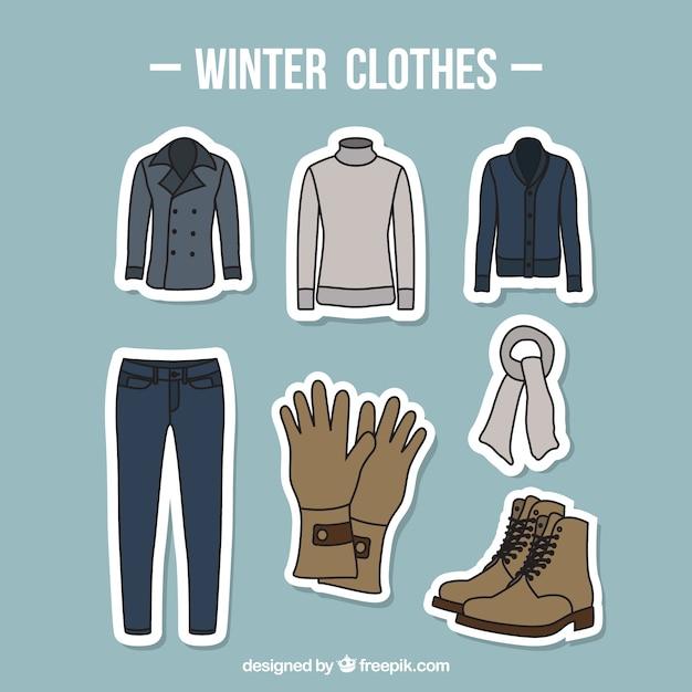 Sammlung von winterkleidung mit zubehör von hand gezeichnet Kostenlosen Vektoren