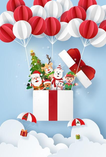 Santa claus und niedlichen charakter in einer geschenkbox mit ballon am himmel Premium Vektoren