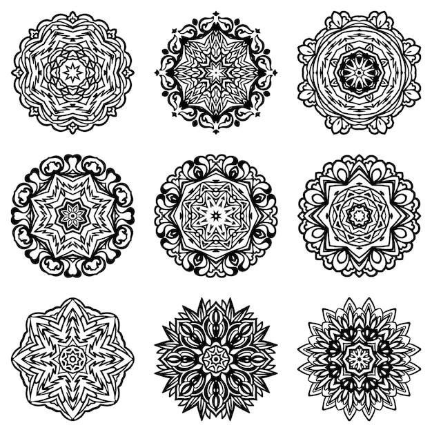 Satz abstrakte schneeflockensilhouette und -rahmen. dekorative formen des schwarzen und weißen mandala-ziers. Premium Vektoren