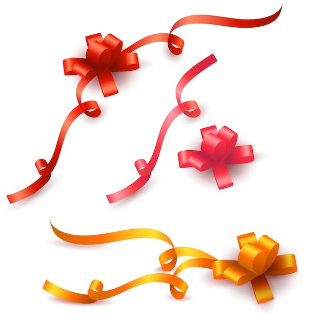 Satz farbiges geschenk beugt mit den bändern, die auf weiß lokalisiert werden Premium Vektoren