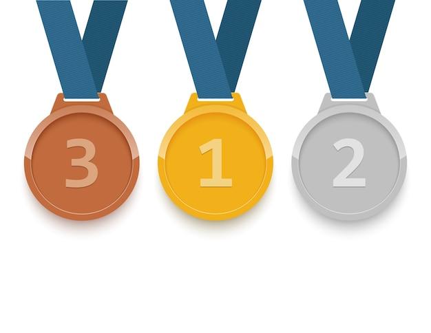 Satz gold-, silber- und bronzemedaillen auf weißem hintergrund Premium Vektoren