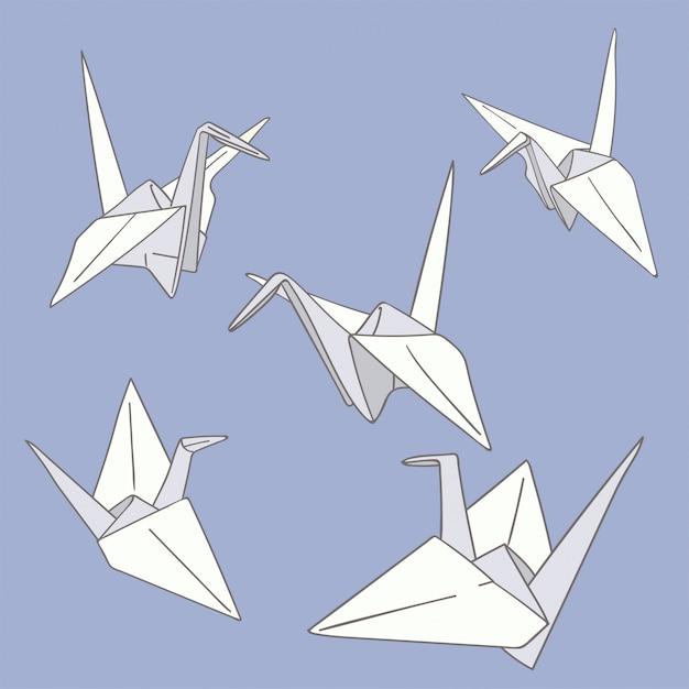 Satz handgezeichnete papierorigami-vögel auf dem blau Premium Vektoren