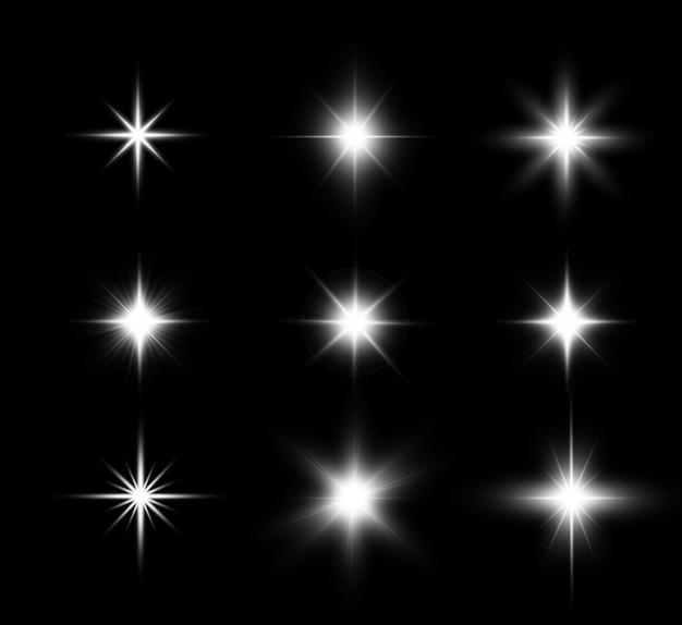 Satz helle schöne sterne funkelnde schöne lichtgrafiken. Premium Vektoren