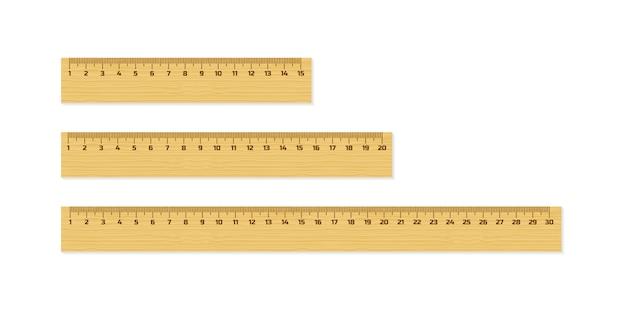 Satz hölzerne machthaber 15, 20 und 30 zentimeter mit den schatten lokalisiert auf weiß. messgerät. schulmaterial Premium Vektoren