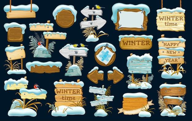 Satz holzbretter mit schneeverwehung. Premium Vektoren