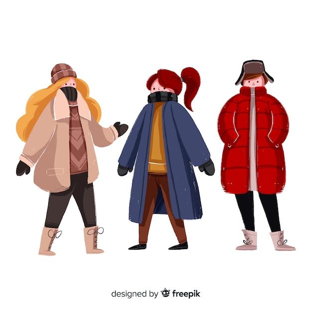Satz leute, die winterkleidung tragen Kostenlosen Vektoren
