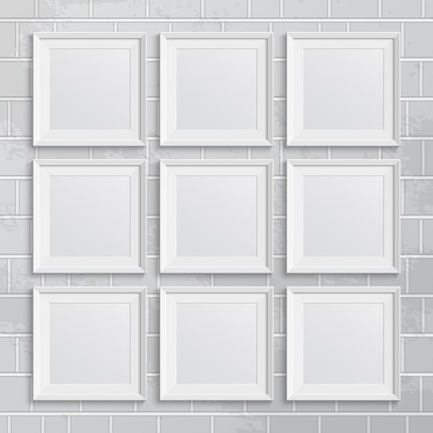 Satz quadratische bilderrahmen auf backsteinmauer. illustration Premium Vektoren