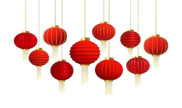 Satz realistische chinesische neujahrslaternen des roten goldes lokalisiert auf weißem hintergrund. Premium Vektoren