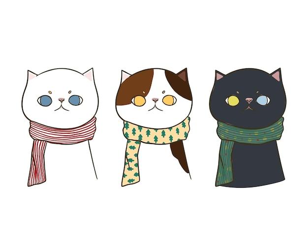 Satz von drei hand gezeichneten gekritzel niedlichen katzen, die einen schal tragen, lokalisiert auf weißem hintergrund. Kostenlosen Vektoren