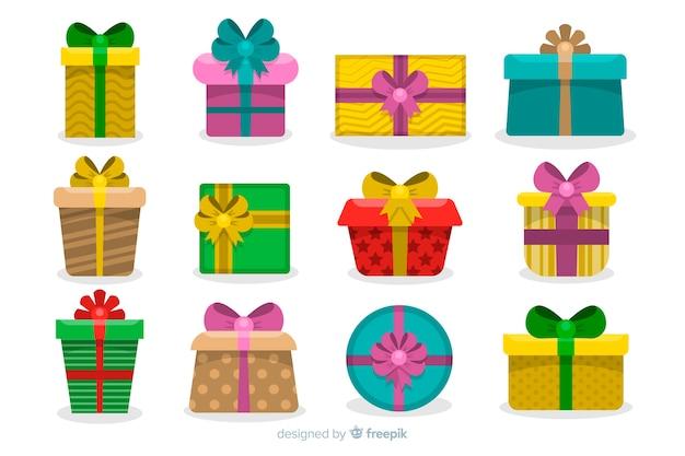 Satz weihnachtsgeschenke im flachen design Kostenlosen Vektoren