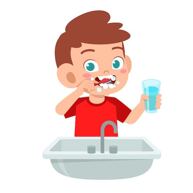 Saubere zähne der glücklichen netten kinderjungenbürste Premium Vektoren