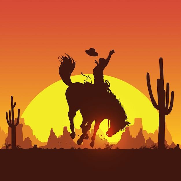 Schattenbild eines cowboys reitet ein wildes pferd bei sonnenuntergang Premium Vektoren