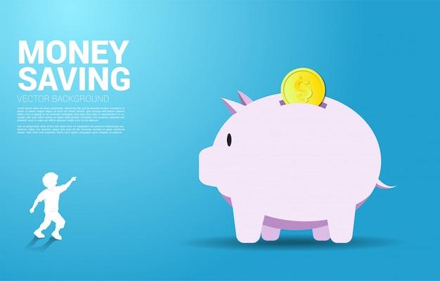Scherzen sie punktfinger vorwärts zum großen sparschwein mit münze Premium Vektoren