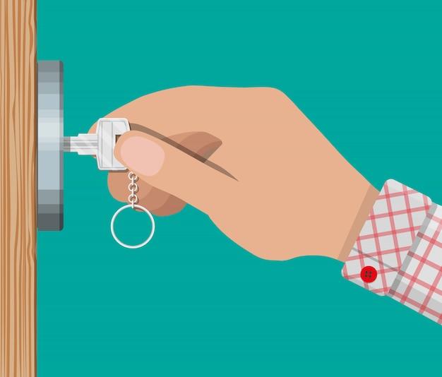 Schlüssel in der hand öffnet holztür. Premium Vektoren