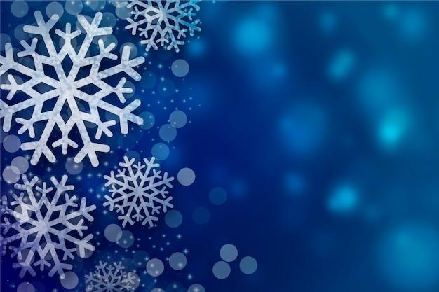 Schneeflockehintergrund mit bokeh exemplarplatz Kostenlosen Vektoren