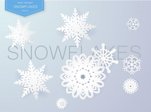 Schneeflocken entwerfen für winter mit platztextraum. abstrakte papierhandwerk-schneeflocken Premium Vektoren