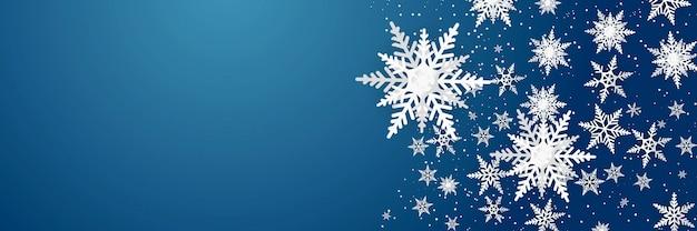 Schneeflocken-luxusmuster auf blauem hintergrund. modernes design für weihnachts-, winter- oder neujahrshintergrundmaterial, abstrakte schneeflockendekoration für grußkarte, verkaufsfahne Premium Vektoren