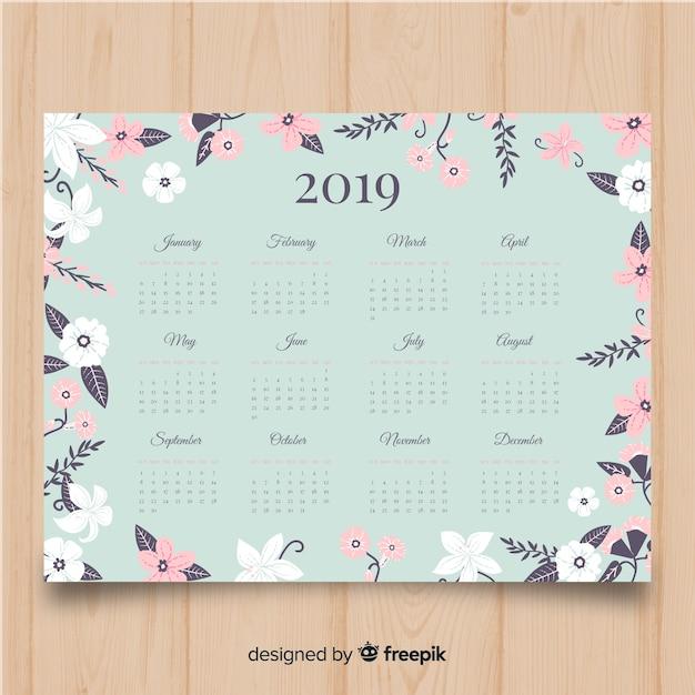 Schöne kalendervorlage 2019 mit blumenart Kostenlosen Vektoren