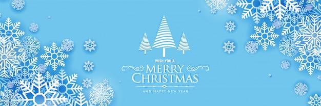 Schöne schneeflockenfahnendesign der frohen weihnachten Kostenlosen Vektoren