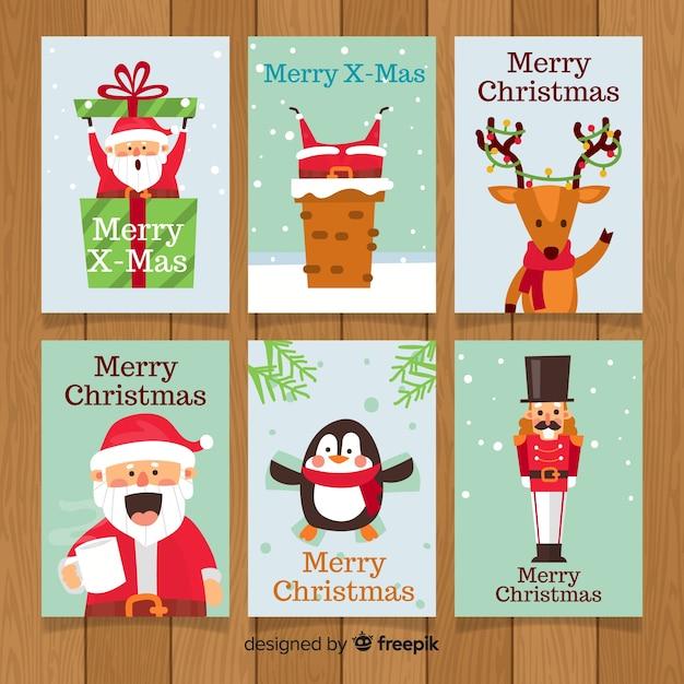 Schöne weihnachtskartensammlung mit flachem design Kostenlosen Vektoren
