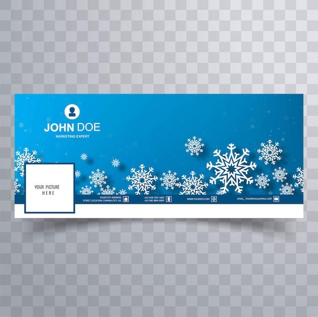 Schöne weihnachtsschneeflocken mit abdeckungsblau Kostenlosen Vektoren