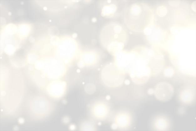 Schöne weiße bokeh lichter bewirken hintergrund Kostenlosen Vektoren