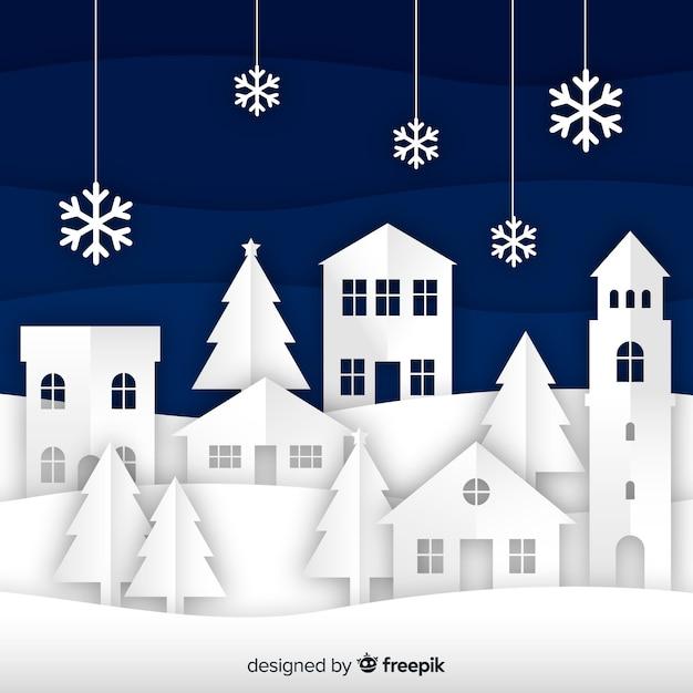 Schöner weihnachtshintergrund mit papierart Kostenlosen Vektoren