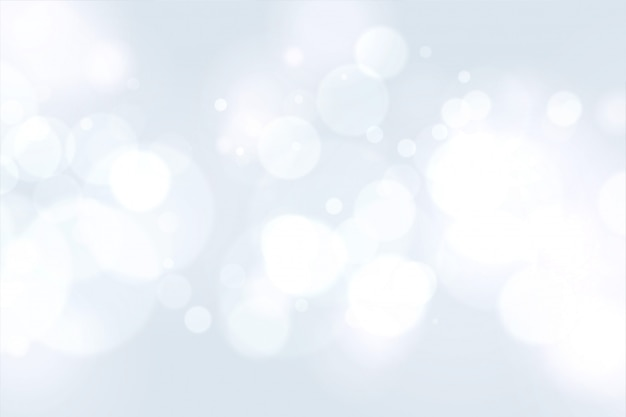 Schönes weiß mit bokeh-lichteffekt Kostenlosen Vektoren
