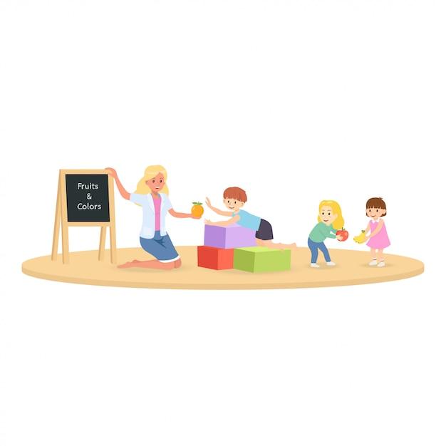 Schüler mit lehrer im klassenzimmer lernen über obst und farbe lektion. Premium Vektoren