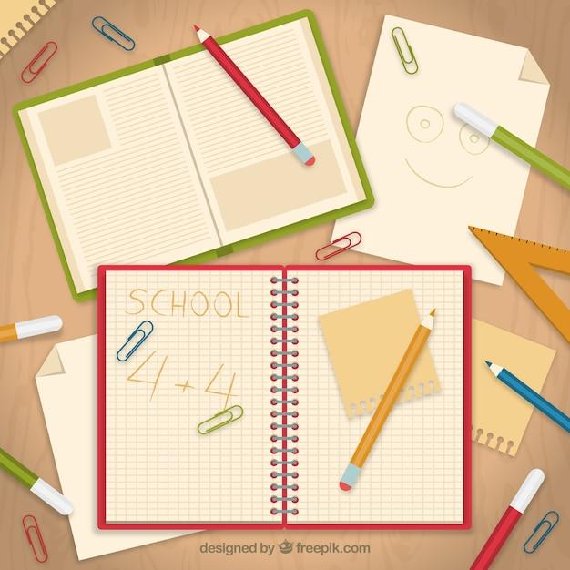 Schulheft mit papieren Kostenlosen Vektoren