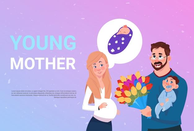 Schwangere frau der jungen mutter mit dem ehemann, der blumen und kleinen sohn über hintergrund hält Premium Vektoren